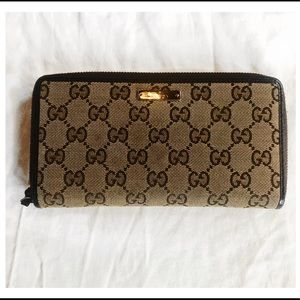 Authentic Gucci monogram canvas supreme zip wallet